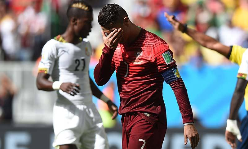 Portugal's forward and captain Cristiano Ronaldo reacts during the Group G football match between Portugal and Ghana at the Mane Garrincha National Stadium in Brasilia during the 2014 FIFA World Cup. -AFP Photo
