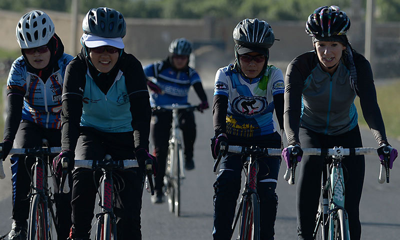 This photograph taken on June 9, 2014 shows members of the Afghan national women's cycling team riding their road bikes in Paghman district of Kabul province. — Photo by AFP