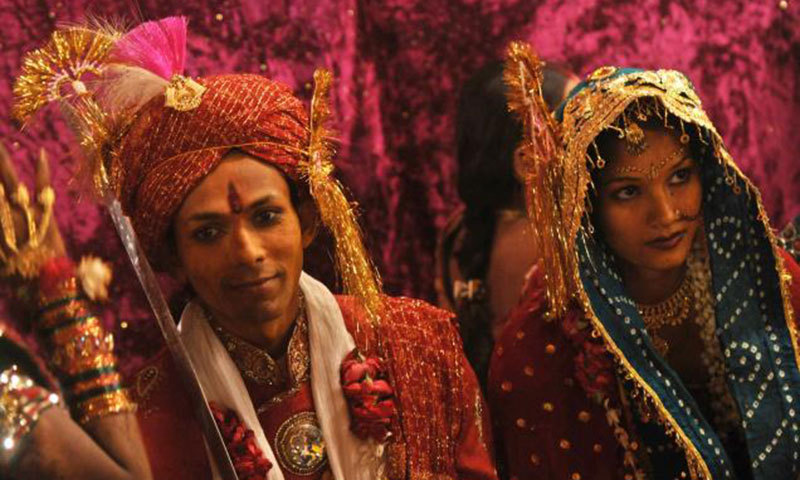 A Pakistani Hindu bride and groom during a mass marriage ceremony. -AFP/File Photo