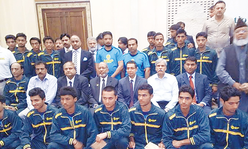LAHORE: Senior NBP officials and former hockey Olympians pose with the U-18 hockey squad during a ceremony here on Saturday.