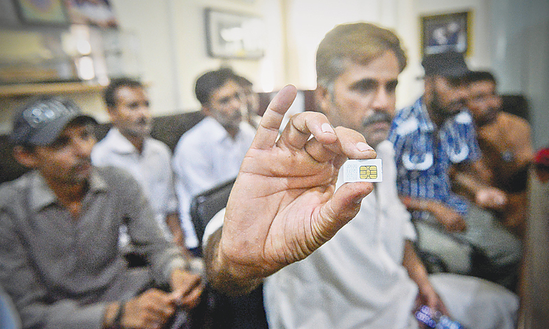 Feroze Bhatti shows the SIM that he managed to hide while being trapped in Somaliland. It was used to make a call back home for rescue. —Fahim Siddiqi / White Star