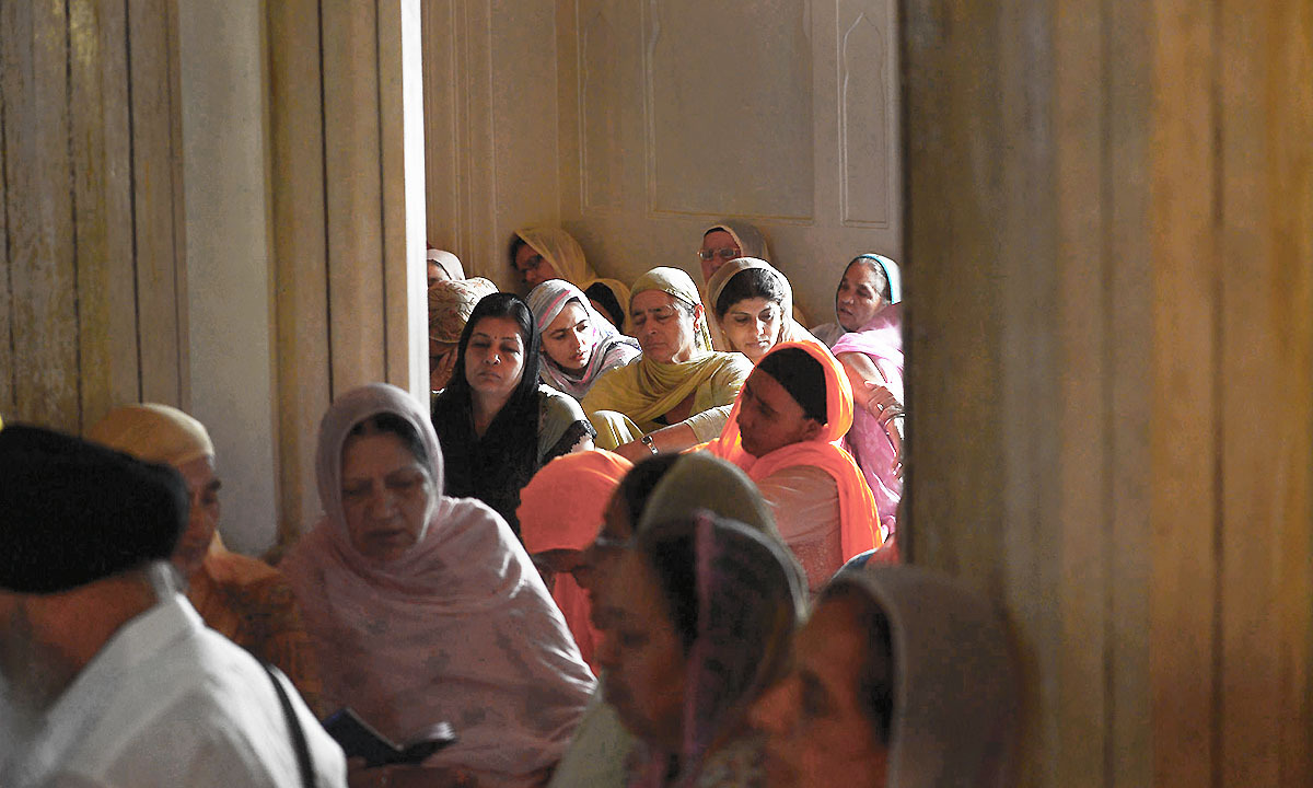 Sikh pilgrims gather at the mausoleum of Maharaja Ranjit Singh during commemorations for his 175th death anniversary in Lahore on June 29, 2014.— Photo by AFP