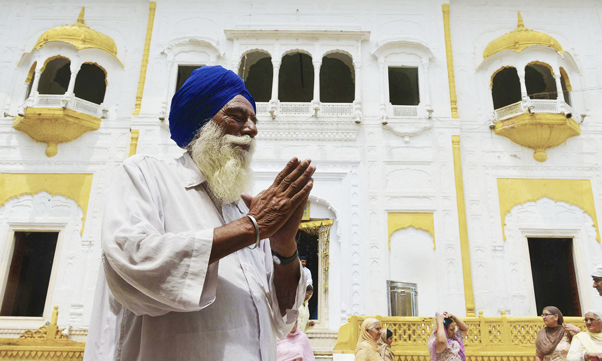 A Sikh pilgrims prays at the mausoleum of Maharaja Ranjit Singh during commemorations for his 175th death anniversary in Lahore on June 29, 2014.— Photo by AFP