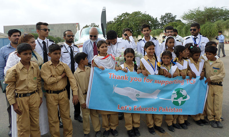 Capts Haris and Babar Suleman pose with TCF children. -Photo by Shazia Hasan