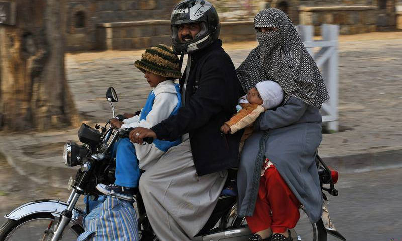 Loose dress with trailing ends is a major contributor to road injuries suffered by women pillion riders in Karachi, says recently launched study. —AP photo
