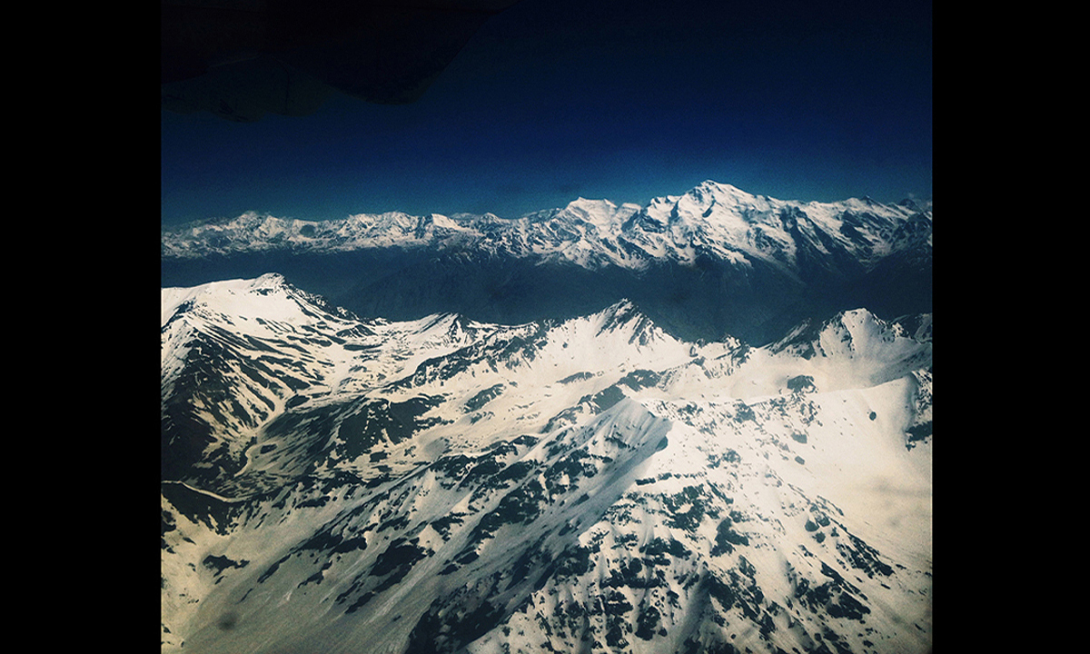 Snow capped mountains: You begin to question why PIA cannot start an air safari. On a good day, the bird's eye view is resplendent with ice-capped peaks, including the K2. —Photo by Kulsum Ebrahim