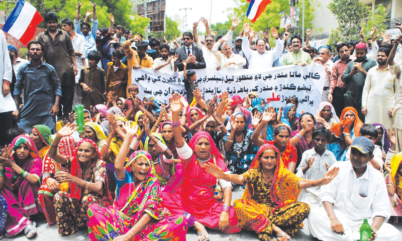 Protesters demonstrate over alleged harassment by political activists.