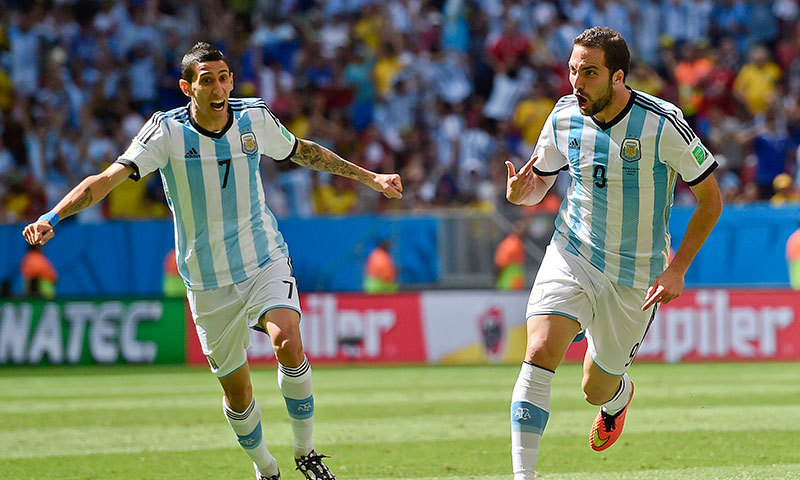 Gonzalo Higuain celebrates with Angel di Maria after scoring the only goal against Belgium at the Estadio Nacional in Brasilia on Saturday. – AP Photo