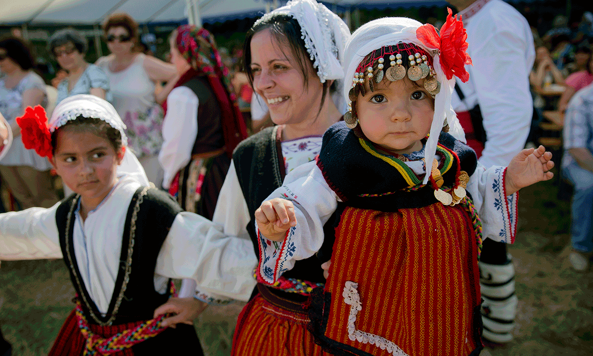 A Bulgarian Woman Holds 2 Year Old Kristina While Dancing At Wedding In Pchelina