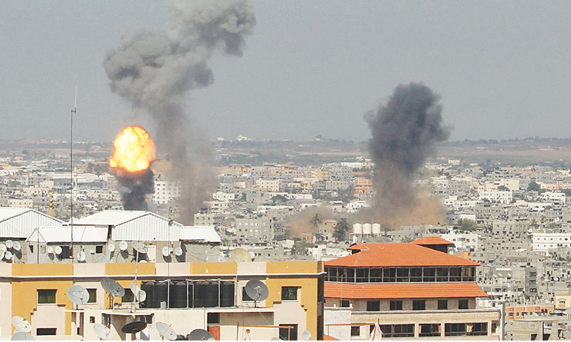 Gaza City: Smoke and flames are seen following an Israeli air strike here on Tuesday.—Reuters
