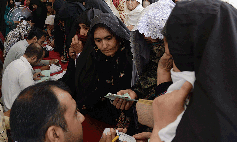 Internally displaced Pakistani civilians fleeing a military operation against Taliban militants in the North Waziristan tribal agency verify their identities at a government registration centre in Peshawar on July 7, 2014. — Photo by AFP