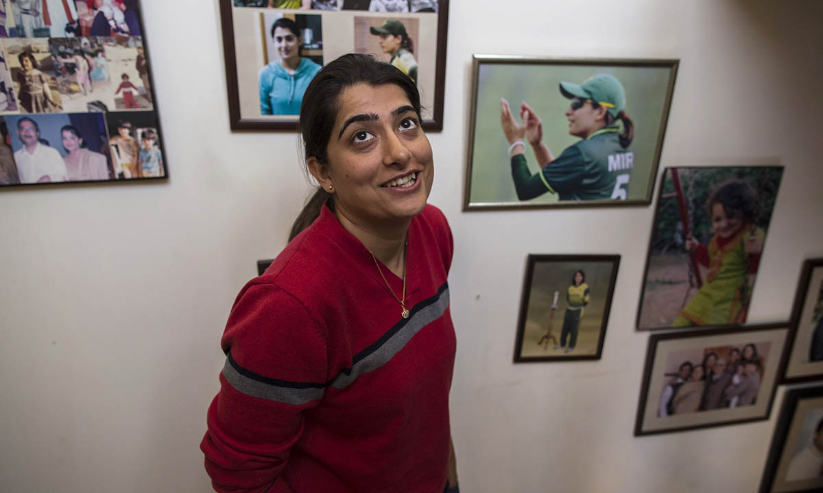 Sana Mir, captain of Pakistan's women's cricket team, smiles as she stands at home in Lahore February 23, 2014. Mir was enrolled in an engineering degree at a national university, but left to pursue her passion for cricket. Though instability continues to plague Pakistan and many areas are dominated by social conservatism, some of the country's more affluent residents have worked to fashion a very different kind of lifestyle for themselves. Pictures of men and women taking part in all sorts of activities and profes