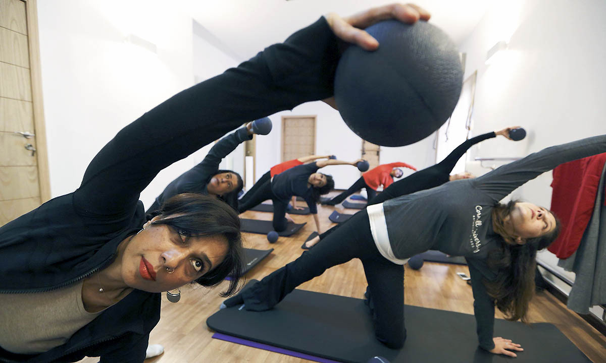 Pilates instructor Zainab Abbas (L) leads a class at her fitness studio in Lahore February 19, 2014.