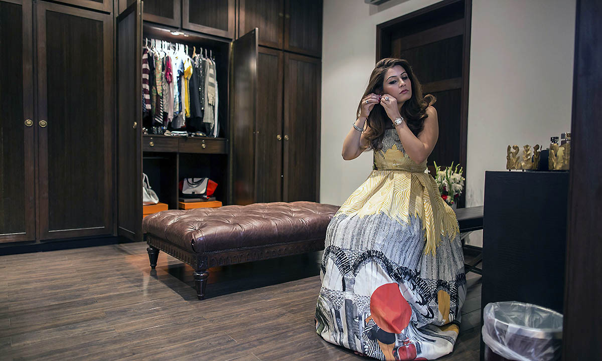Aleena Raza gets ready for a party in her dressing room in Lahore May 29, 2014.