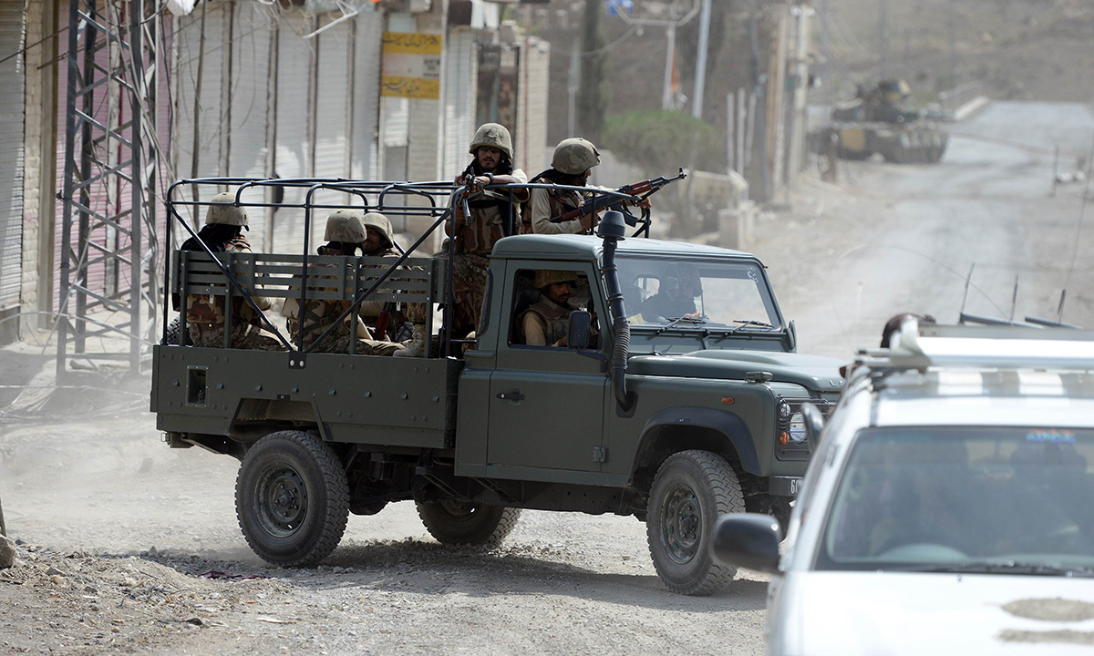 This photograph taken on July 9, 2014 shows soldiers patrol during a military operation against Taliban militants, in the main town of Miramshah in North Waziristan.— Photo by AFP