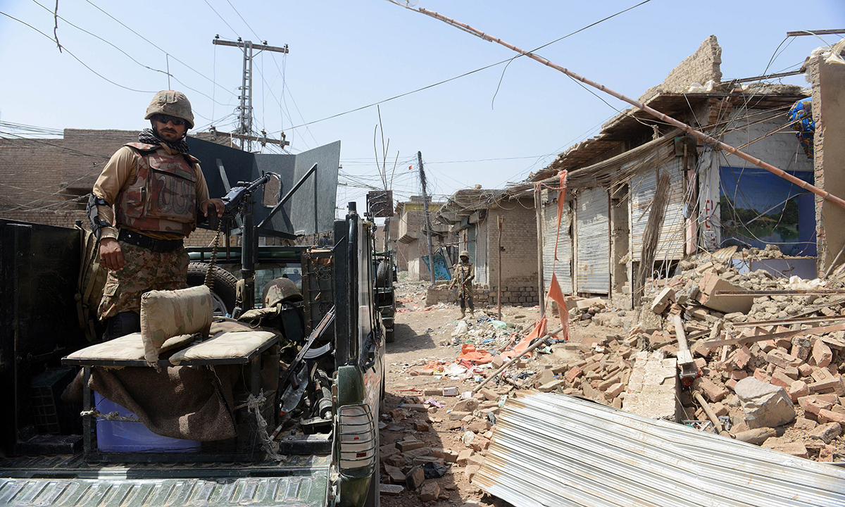 This photograph taken on July 9, 2014 shows soldiers patrol during a military operation against Taliban militants, in the main town of Miramshah in North Waziristan. — Photo by AFP