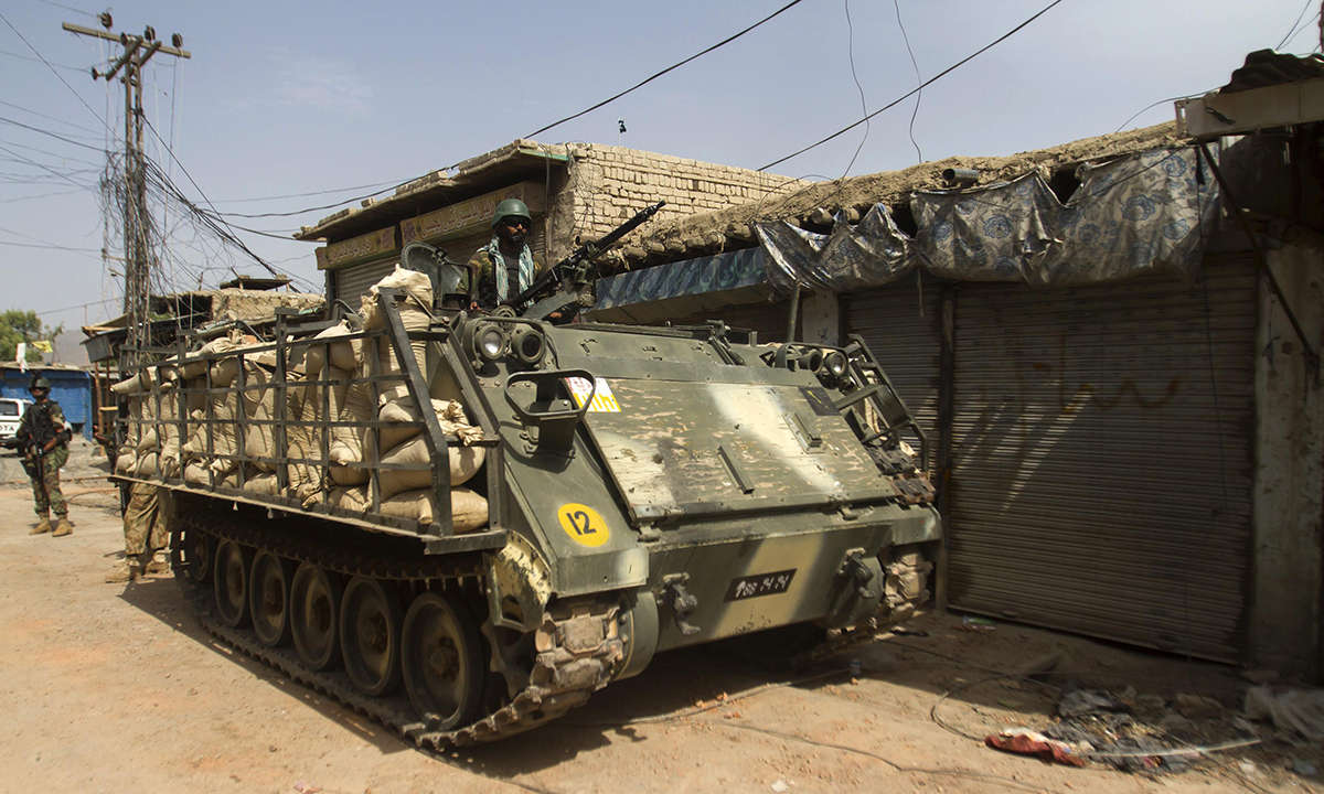 A soldier stands in an armoured vehicle during a military operation against Taliban militants in the town of Miramshah in North Waziristan July 9, 2014. — Photo by Reuters
