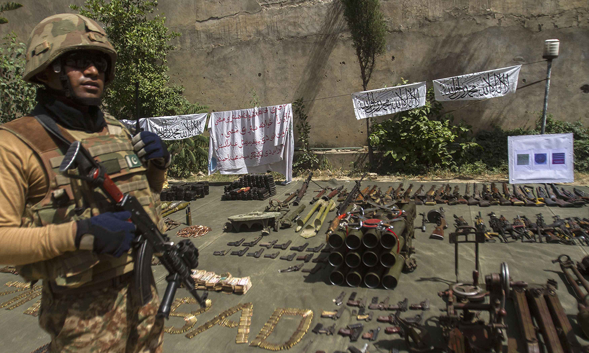 A soldier stands by ammunition seized during a military operation against Taliban militants, in the of town of Miramshah, North Waziristan July 9, 2014. — Photo by Reuters