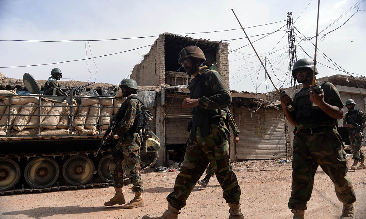 Pakistani soldiers patrol at an empty bazaar during a military operation against Taliban militants in the main town of Miranshah in North Waziristan on July 9, 2014. Last month Pakistan's military launched a long-awaited offensive in North Waziristan, aimed at wiping out longstanding militant strongholds in the area, which borders Afghanistan. More than 800,000 people have fled a major military offensive against the Taliban in a Pakistani tribal area, officials said Wednesday. AFP PHOTO/Aamir QURESHI