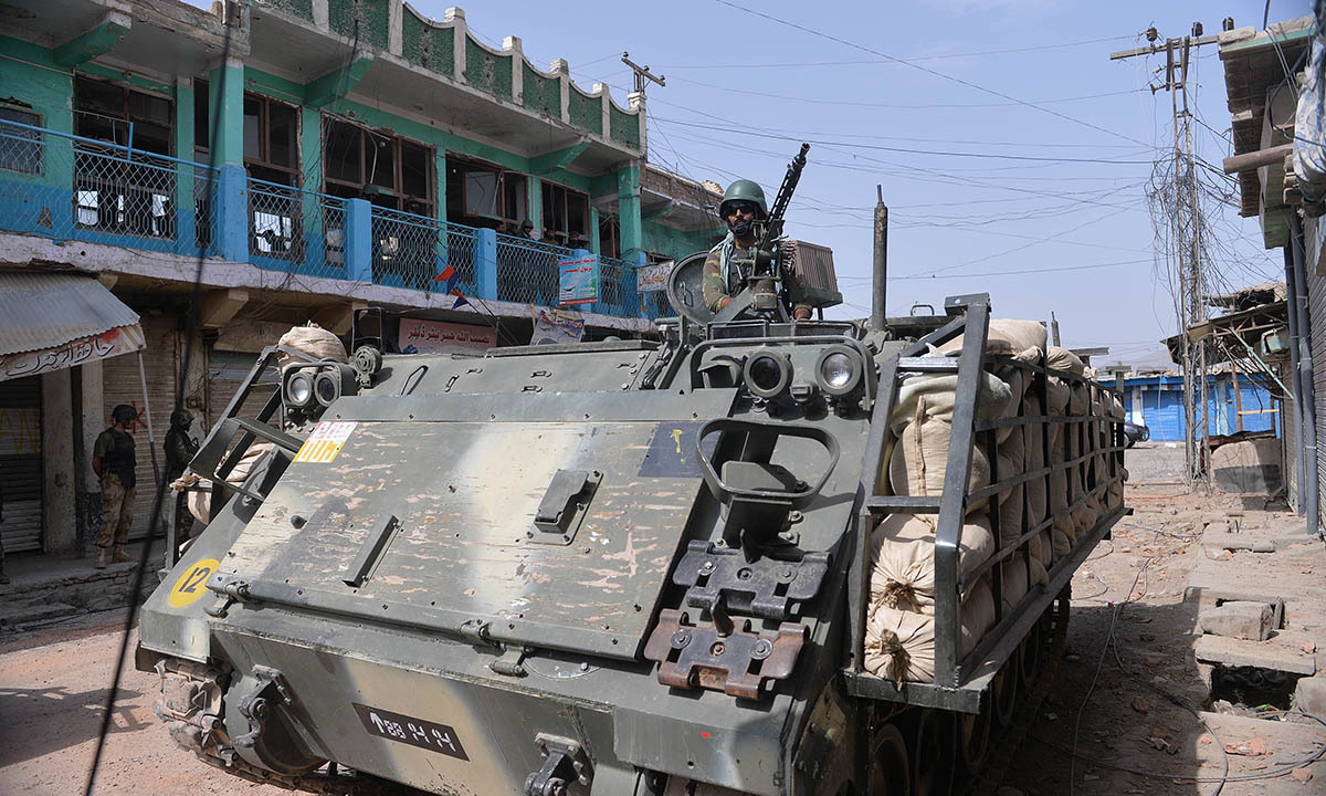 Soldiers patrol with an armoured vehicle at an empty bazaar during a military operation against Taliban militants in the main town of Miramshah in North Waziristan on July 9, 2014.— Photo by AFP