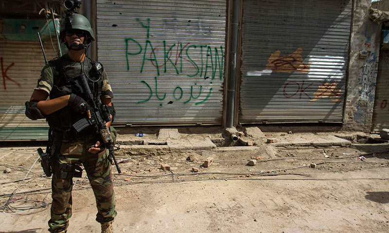 A Pakistani soldier stands in front of closed shops during a military operation against Taliban militants in the town of Miranshah in North Waziristan July 9, 2014. — Photo by Reuters