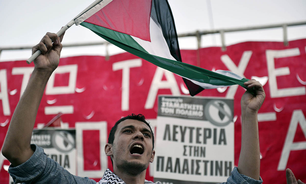 A Palestinian who lives in Greece shouts slogans on July 10, 2014 near the Israeli embassy in Athens, during a demonstration by Palestinians and Greeks who support them against Israeli air strikes on the Gaza strip. — Photo by AFP