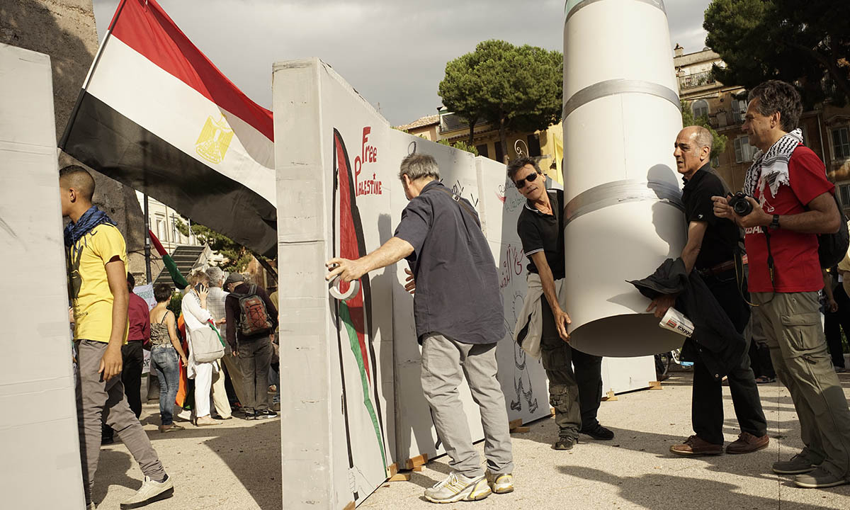 Demonstrators erect a cardboard wall to symbolize the West Bank barrier during an anti-war protest against the Israeli operation in Gaza, in Rome, Friday, July 11.  — Photo by AP