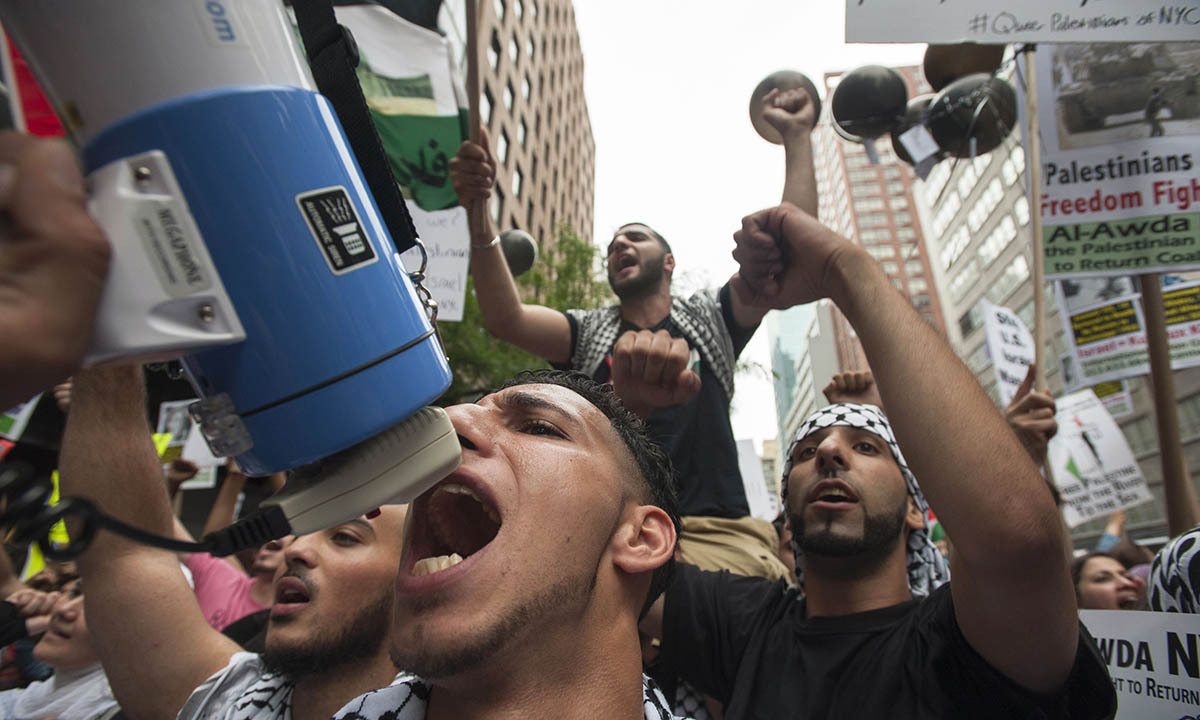 """Protesters shout, """"Free Palestine"""", during a march demanding an end to the escalating Israeli-Palestinian hostilities in that region, in midtown Manhattan, New York July 9, 2014.   — Photo by Reuters)"""