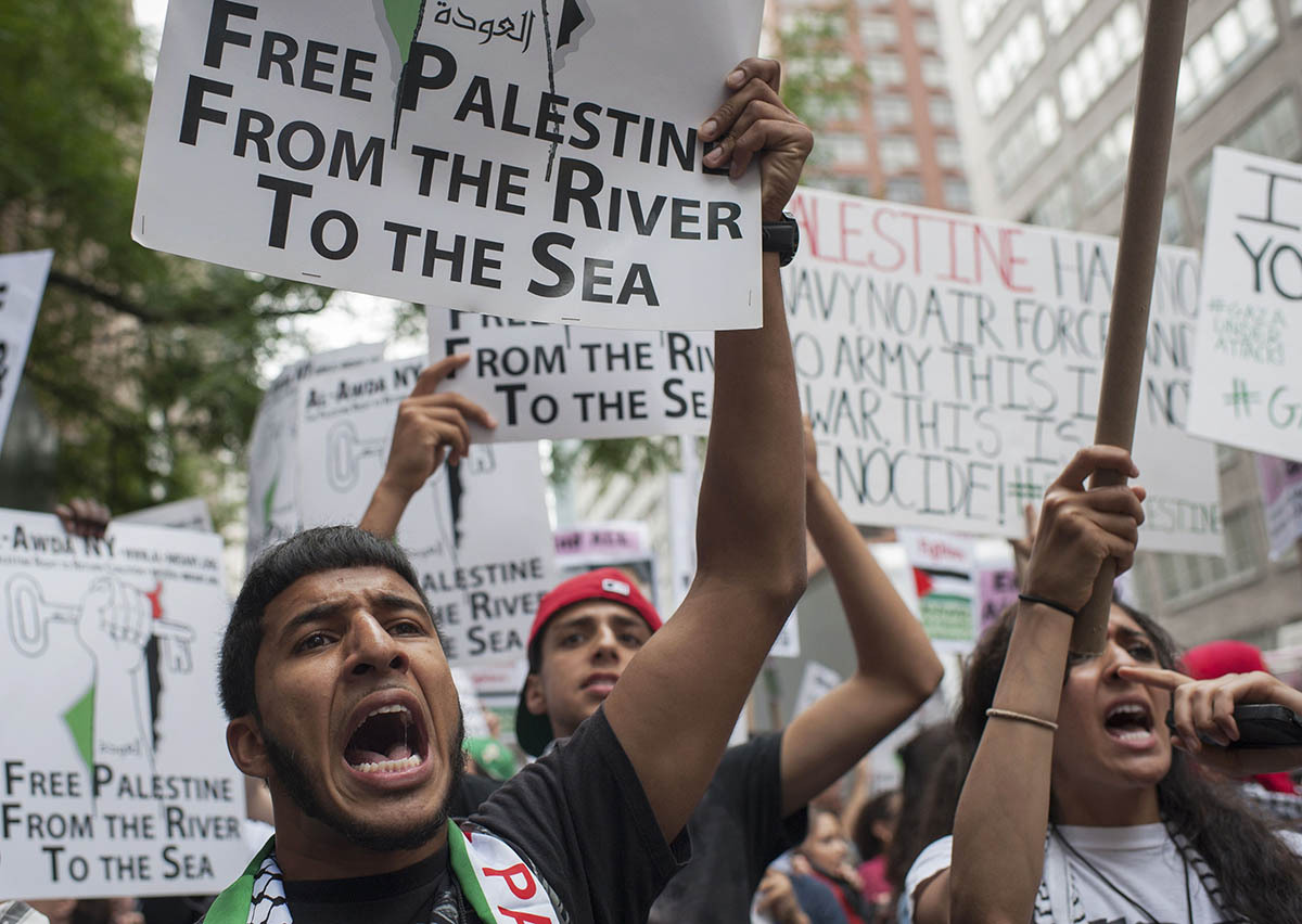 """A man shouts """"Free Palestine"""" during a march demanding an end to the escalating Israeli-Palestinian hostilities in that region, in midtown Manhattan, New York July 9, 2014. — Photo by Reuters"""