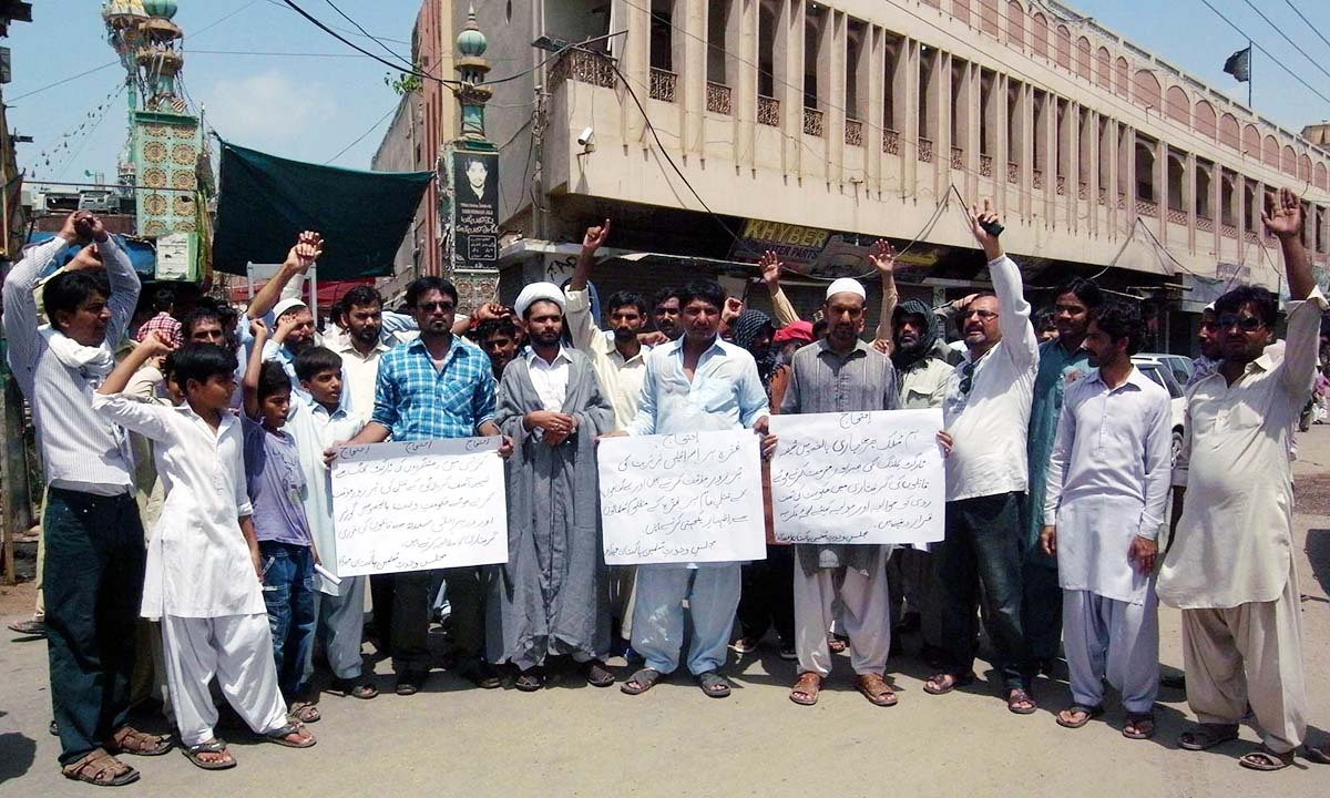 Activists of a religious organisation protest against killing of Muslims in Syria, Iraq and Palestine at Qadamgah Mola Ali in Hyderabad on Friday, July 11, 2014.— Photo by PPI