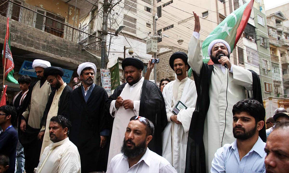 A religious scholar is addressing protestors during a demonstration held outside Kharadar Imam Bargah in Karachi against the Israeli assault in Gaza on Palestine. — Photo by Online