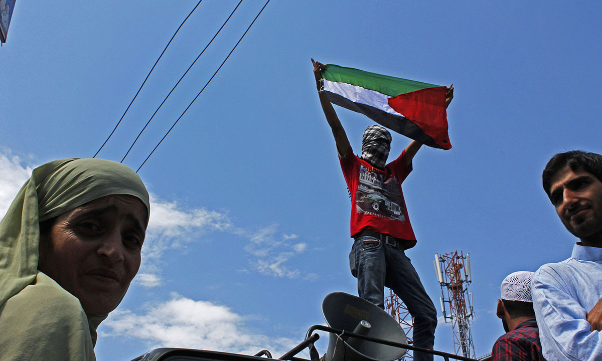 A protestor holds a Palestinian flag during an Anti-Israeli protest in old city Srinagar in India-held Kashmir on July,11 2014. — Photo by Faisal Khan