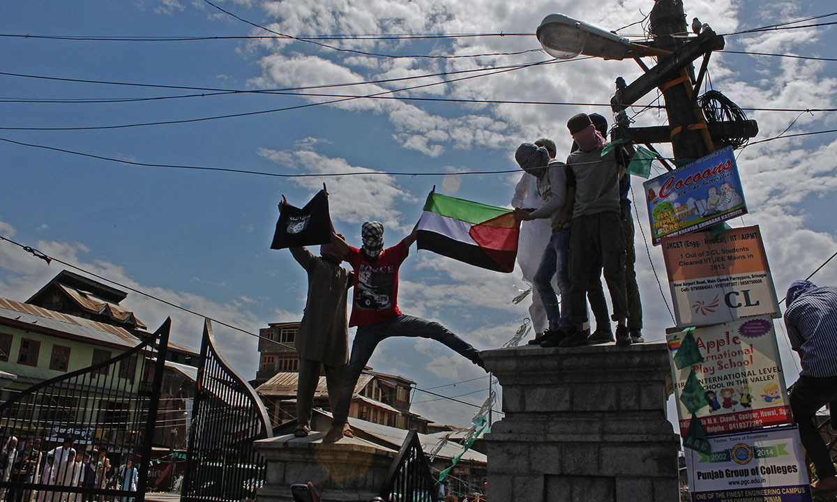 Protesters hold a Palestinian flag during an Anti-Israeli protest in old city Srinagar in India-held Kashmir on July,11 2014.  — Photo by Faisal Khan