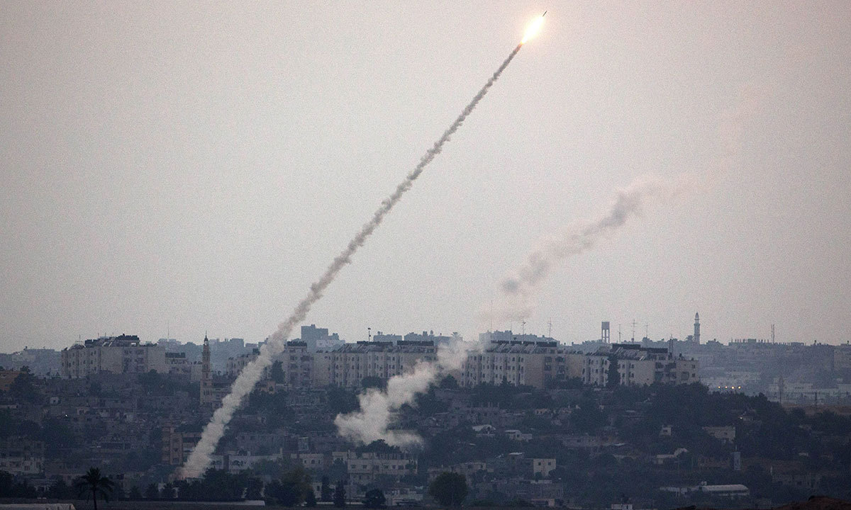 A picture taken from the southern Israeli Gaza border shows rockets being fired from the Gaza strip into Israel, on July 12, 2014. — Photo by AFP