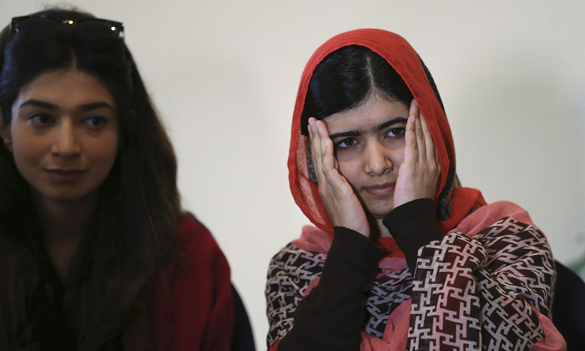 Pakistani schoolgirl activist Malala Yousafzai (R) reacts as she listens during a meeting with the leaders of the #BringBackOurGirls Abuja campaign group, in Abuja July 13, 2014. Seen on left is Malala Fund CEO Shiza Shahid. – Photo by Reuters