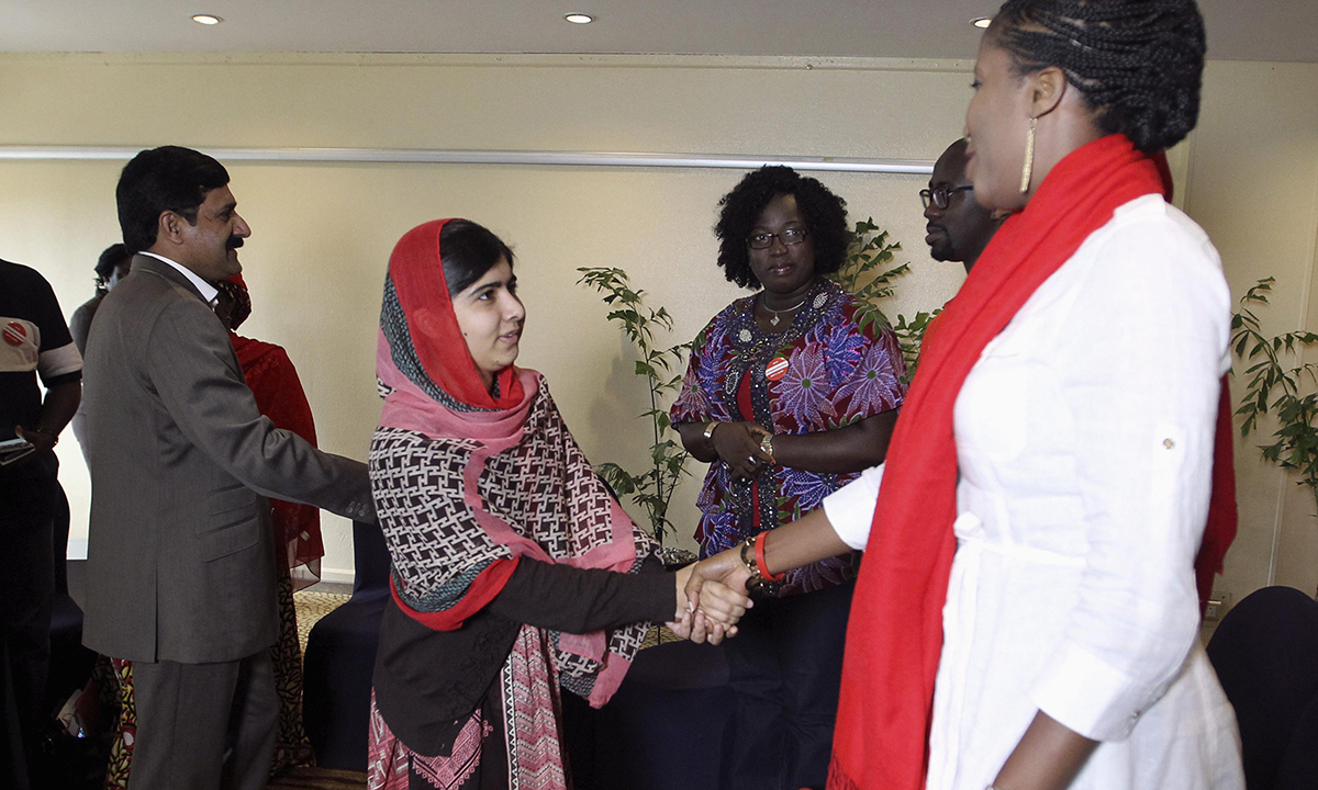 Pakistani schoolgirl activist Malala Yousafzai (2nd L) shakes hands as she is welcomed during a meeting with the leaders of the #BringBackOurGirls Abuja campaign group, in Abuja July 13, 2014. – Photo by Reuters