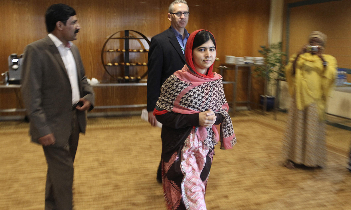 Pakistani schoolgirl activist Malala Yousafzai arrives for a meeting with the leaders of the #BringBackOurGirls Abuja campaign group, in Abuja July 13, 2014. – Photo by Reuters
