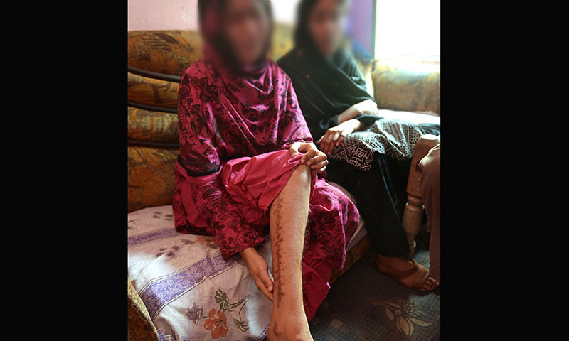In this photograph taken on May 8, 2014, sisters Shumaila* and Rabia*, who were trapped in the sex trafficking trade by a neighbour and held hostage in a brothel in Dubai, speak during an interview with AFP in Faisalabad, where they are in hiding with their family.— Photo by AFP