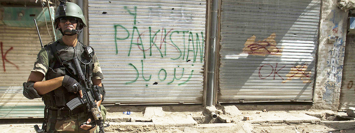 A soldier stands in front of closed shops during a military operation in the town of Miramshah. — Photo by Reuters