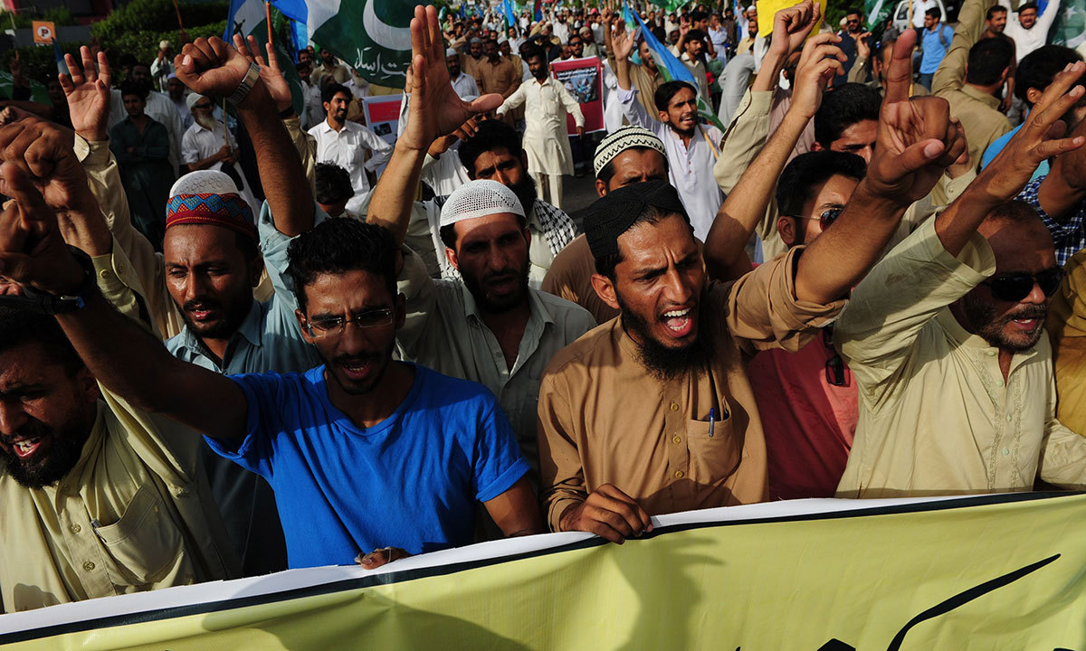 Activists of Jamaat-i-Islami march during an anti-Israel and US protest against Israel's military campaign in Gaza, in Karachi on July 13, 2014. — Photo by AFP