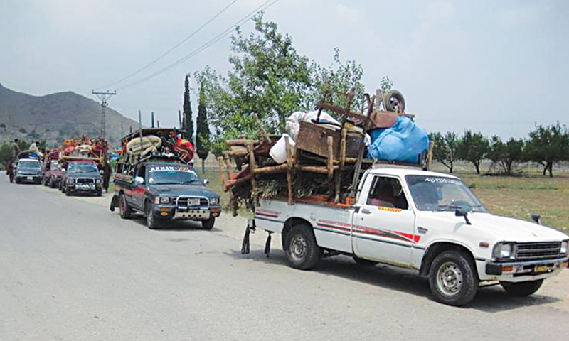 Residents of Loi Mamond tehsil of Bajaur Agency leaving their areas amid indications of a military operation against militants.—Dawn