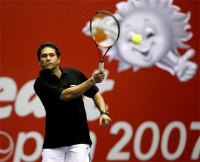 Tendulkar practices hitting a bowlers-back-drive at a Mumbai tennis club.