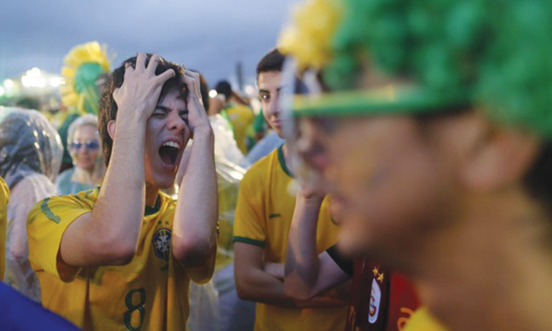 A Brazilian fan reacts to the 1-7 semi-final defeat to Germany