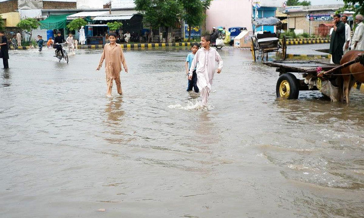 HARIPUR: Different roads of the city were wearing the look of a pond after rain in the city. — Photo by Online