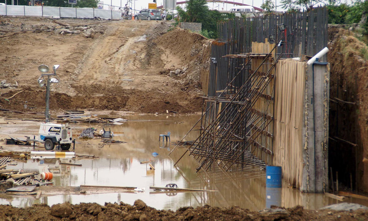 ISLAMABAD: A view of rain water accumulated on the site of Metro Bus Project at Jinnah Avenue. — Photo by INP