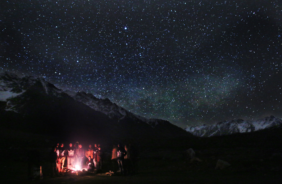 Moin Khan with friends camping in Shandur, Gilgit Baltistan. Photo by Usman Khan