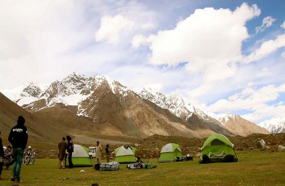 Moin Khan with his companions at their Shandur campsite. Photo courtesy: ADifferentAgenda