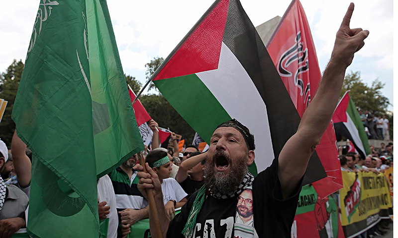 Pro-Palestinian Turks stage a protest rally at Fatih Mosque, in Istanbul — AP Photo