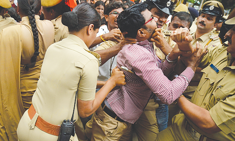Bangalore (India): Police detain an activist of a student organisation during a protest on Wednesday against the sexual assault of a six-year-old girl earlier this month. —Reuters