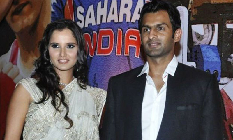 Sania Mirza (L) and her husband Shoaib Malik (R). — Photo by AFP